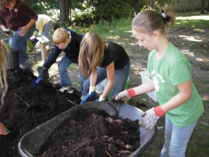 Students from St. Peter's Lutheran School planted flowers in the Mitchell Creek Watershed.